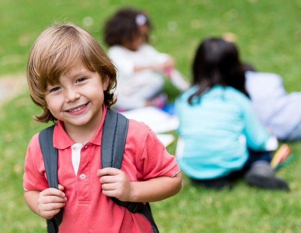 happy boy wearing backpack
