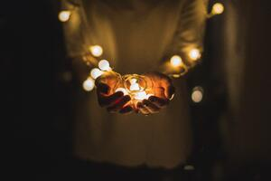 person holding lights christmas