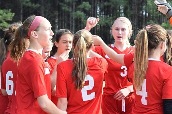 girls soccer team cheering