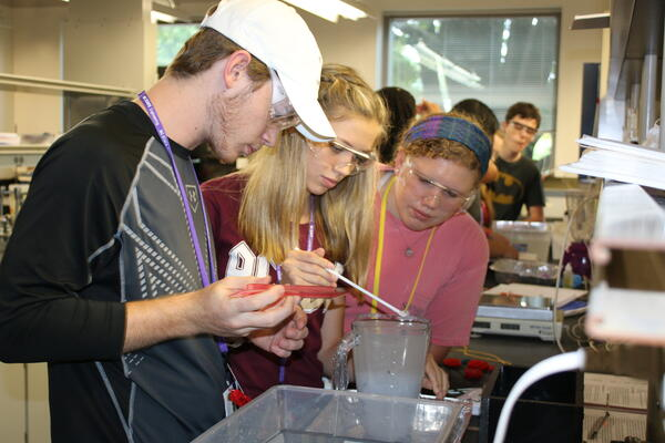 summer science camp students experiment