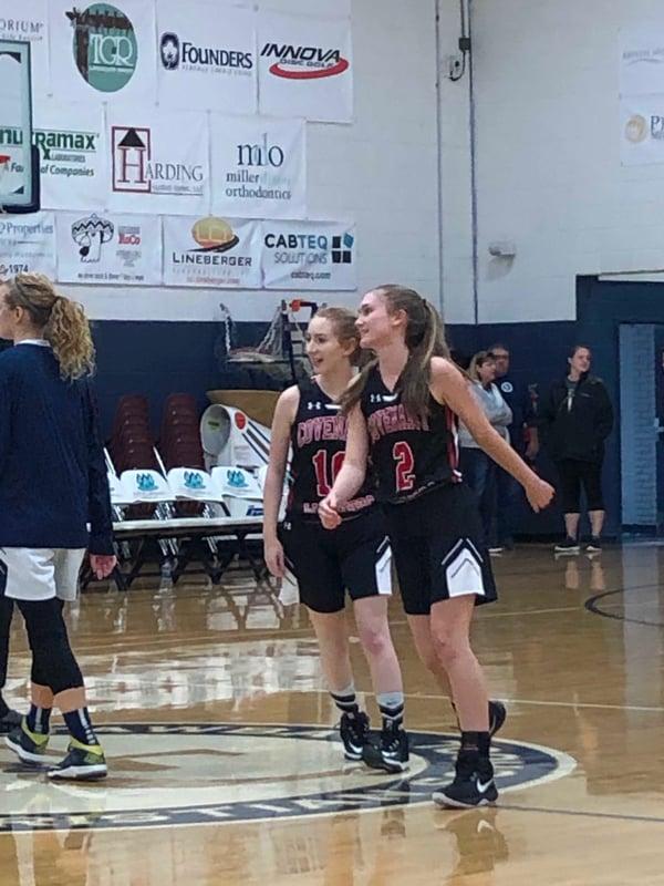 girls smiling playing basketball