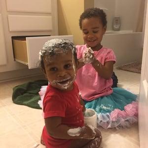 grandchildren playing bathroom floor